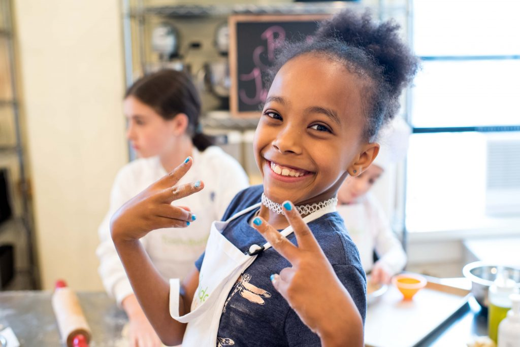 Happy kids enjoying summer cooking camp at Taste Buds Kitchen