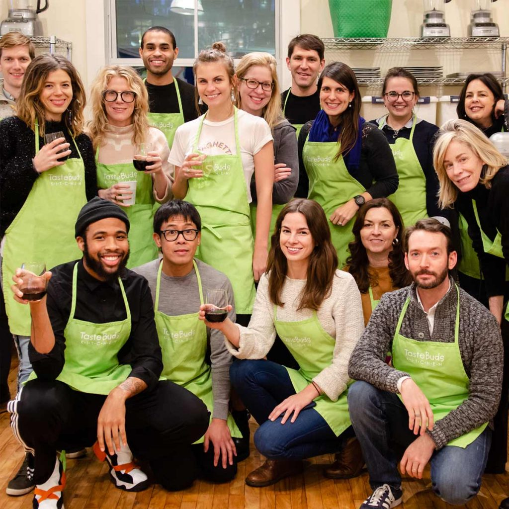 Having fun at a corporate cooking team building event at Taste Buds Kitchen