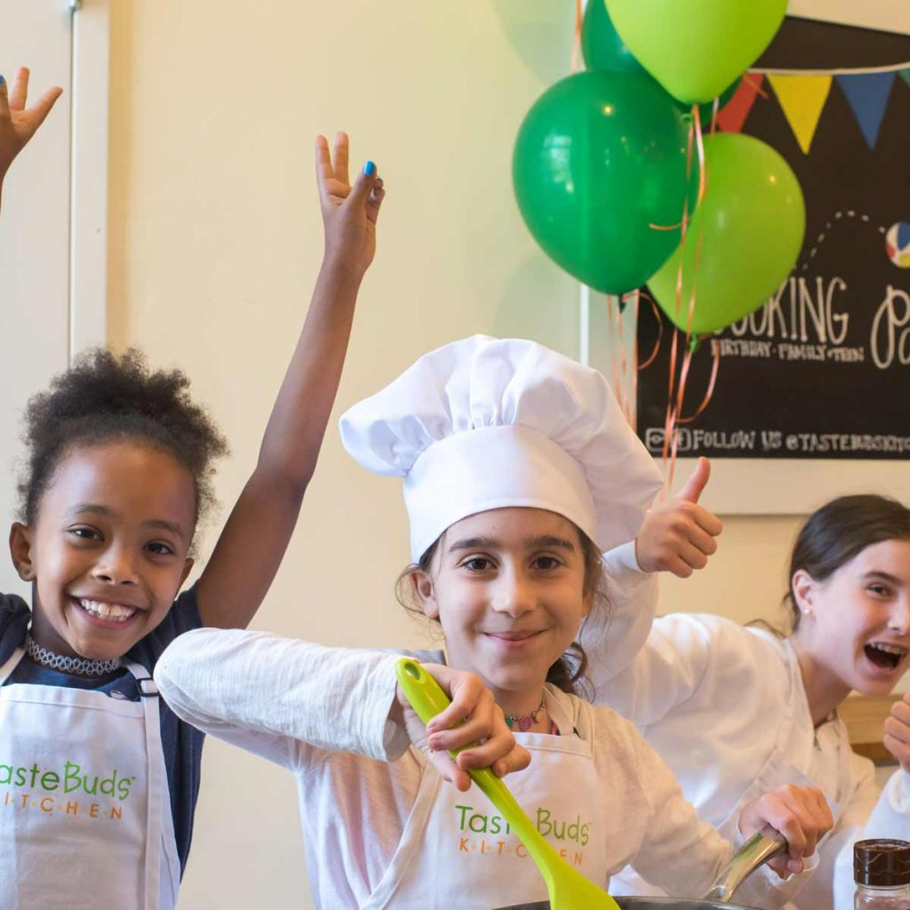 Kids having a blast celebrating with a cooking birthday party at Taste Buds Kitchen