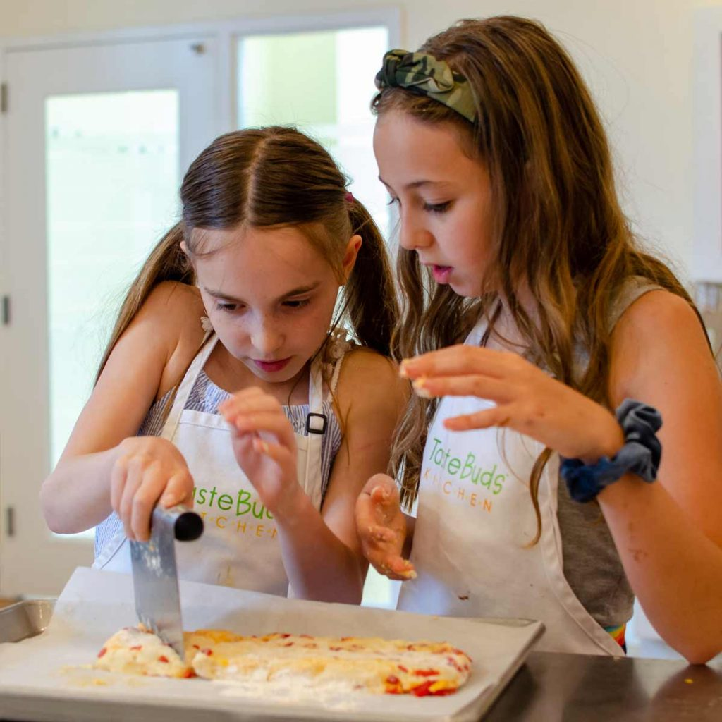 Kids cooking together during a Cooking Field Trip to Taste Buds Kitchen